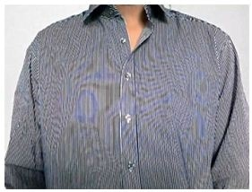 A striped shirt develops a new pattern that has twists and curved lines.
