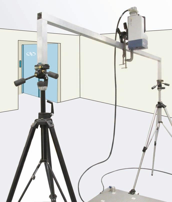 In the test configuration, the laser head was attached to the gantry above the measured surface.