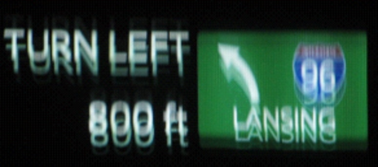 Ghosting of the image is caused by misalignment of HUD projections that are reflected back from the windshield.