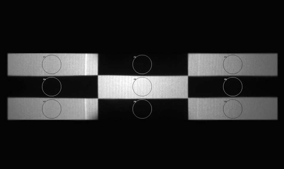 A checkerboard test pattern projected by a HUD system is analyzed by light measurement software to calculate the contrast ratio by dividing the average white values with average black values. A human inspector, however, may not need to  perform a calculation to make a quality determination.