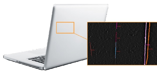 Scratches on the back of a laptop are identified and qualified based on their severity. The values shown in this analysis image provide contrast ratios relative to a background level.