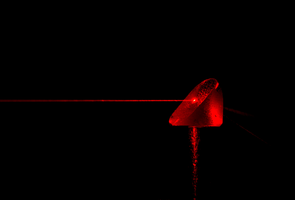 A red laser shown through water