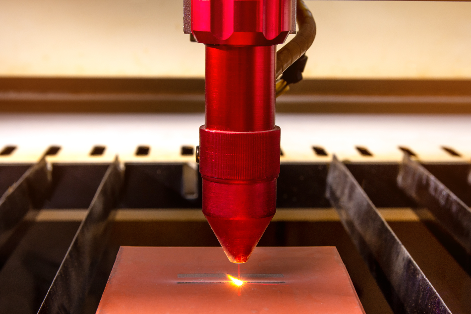Closeup Laser engraver working and engraving flat ceramic stone