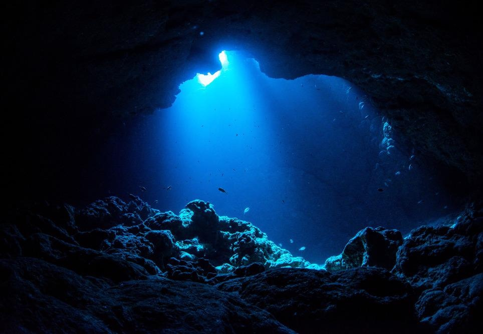 ray of light shining on underwater cave