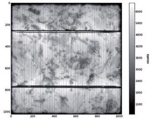Electroluminescence image of a multicrystalline 12:5 x 12:5 cm2 cell at 20mA/cm2 excitation current density and exposure time of 10s.