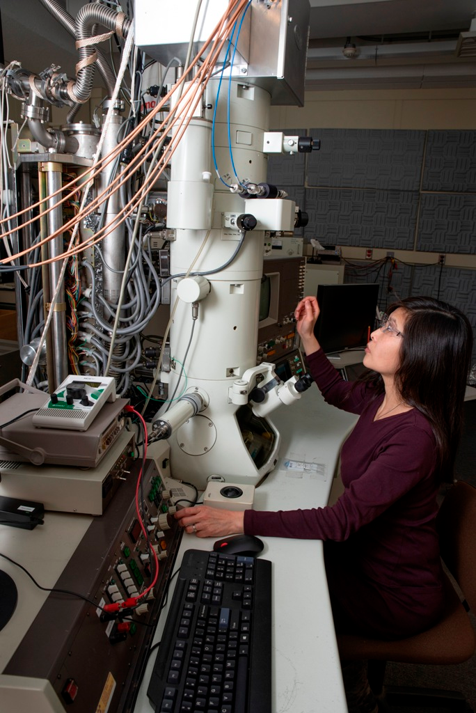 NIST researcher June Lau with a transmission electron microscope (TEM) that she and her colleagues retrofitted in order to make high-quality atom-scale movies
